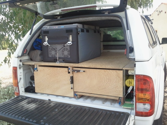 Waeco fridge mounted on slide out shelf on top of drawers in back of hilux