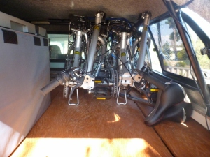 two stowabike city bikes folded in back of hilux