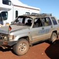 banged up 4WD parked at Uluru