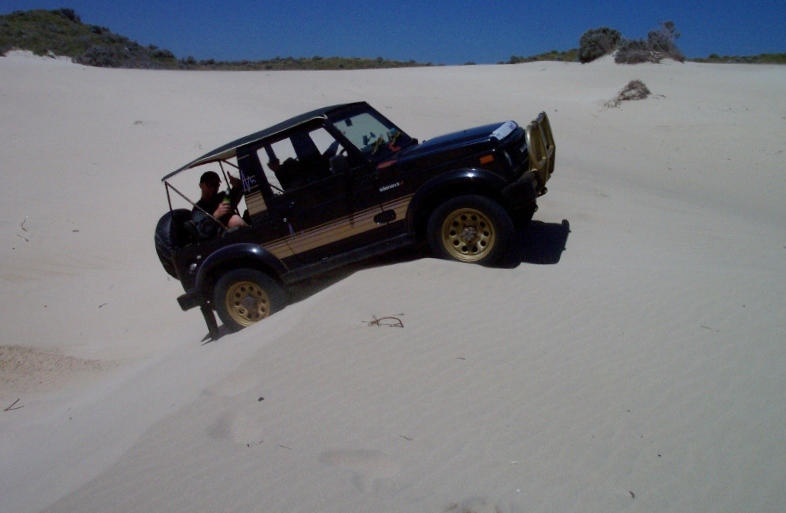 sand driving ascending steep sand dune, ledge point, western australia