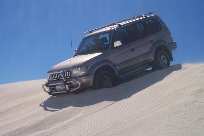 sand driving descending steep sand dune, lancelin sand dunes, western australia