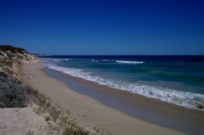 Driving on sand - Narrow, boggy, sloping beach, two rocks, western australia