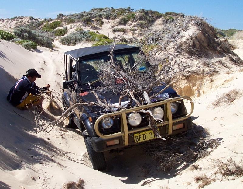 stuck in sand, wheel lifted, start shovelling