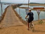 riding over bamboo bridge