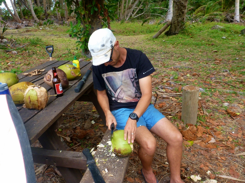 chopping green coconut at chili beach