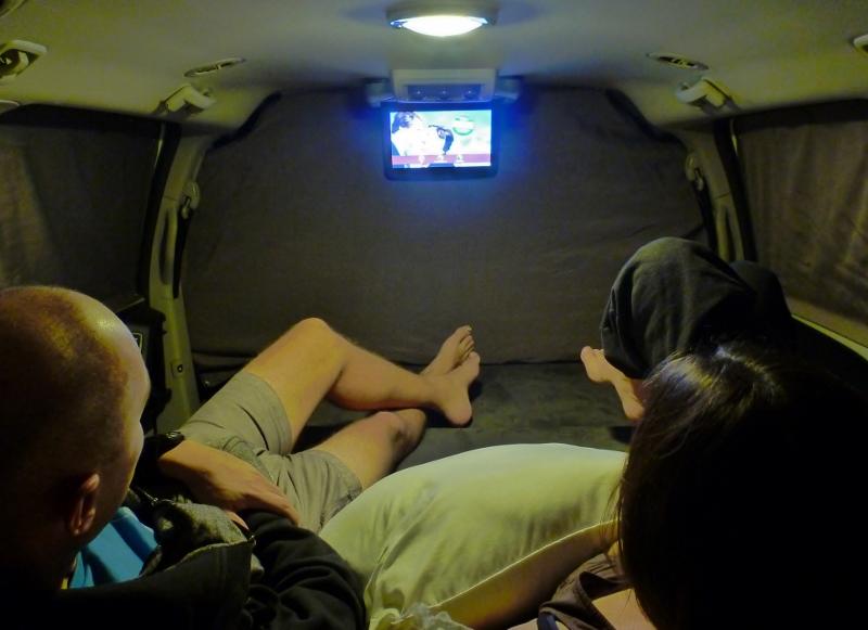 watching dvd in walmart carpark